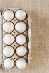White fresh eggs on gray background.  Rural still life, natural organic healthy food with free space. Close up