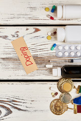 Drugs and medals on wood. Doping in sport - the truth.