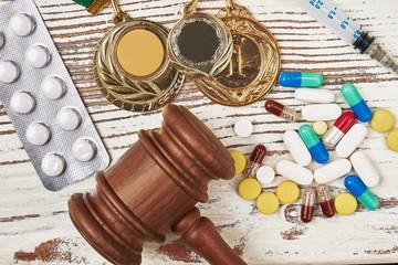 Hammer, medals, syringe and pills. Should doping be criminalised?