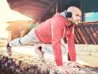 Young sportsman during his training outdoors. Sport, fitness, street workout concept