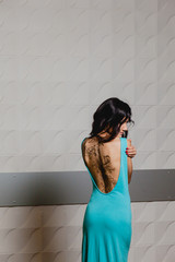Slender brunette with henna ornaments drawn on her back
