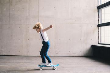 Little boy teaching skate on the skateboard