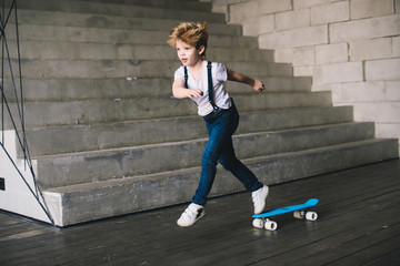 Little boy skate on the skateboard