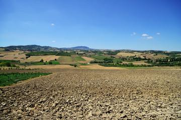 Countryside in Coriano, plowed field (near Rimini), Emilia-Romagna, Italy. Far viev to Monte Titano and San Marino.