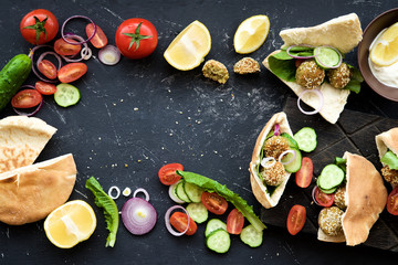 Falafel with sesame and vegetables in pita. Eastern cuisine, healthy snack