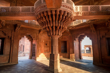 Fatehpur Sikri intricate red sandstone artwork inside Diwan-i-khas which bears the heritage of Mughal India architecture. A UNESCO World heritage site at Agra India.