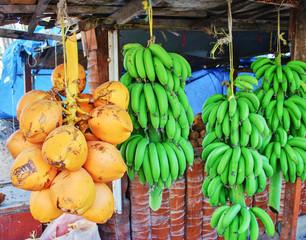 Fresh green banana and coconuts
