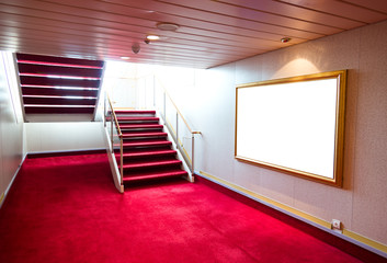 Red carpet on a stairway in a luxury cruise.