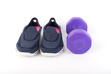 Blue sport shoes and dumbbell on white background,exercise project