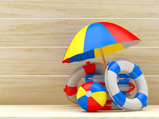 Beach umbrella, ball and pile of lifebuoys on wooden background with space for text. 3D illustration