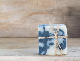 Handmade indigo soap on wooden dark background