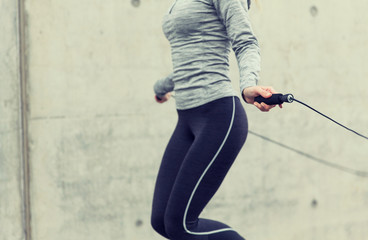 close up of woman exercising with jump-rope Wall mural