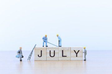July words with Miniature people worker
