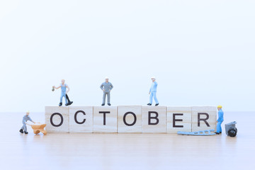 October words with Miniature people worker