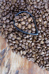 Roasted coffee beans of three different level in black bow on grunge wooden background