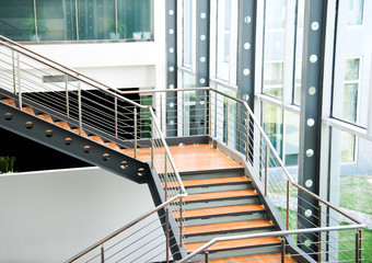 Empty office stairs with handrail in a modern building.
