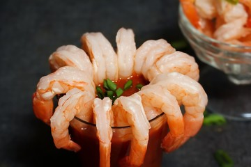 Shrimp Cocktail with red sauce on dark moody setting, selective focus