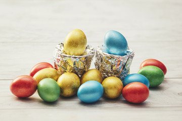 Colorful Easter eggs with stands of silver foil