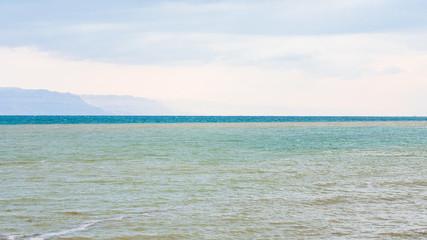 water of Dead Sea in winter morning