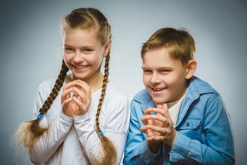 Cunning boy and girl conceived trick. Communication concept.
