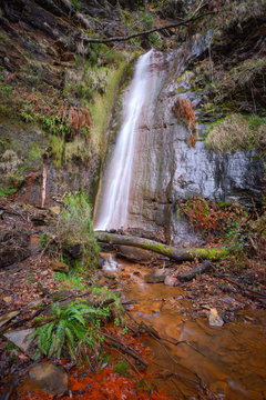 The red ferruginous waters of the Rexio waterfall