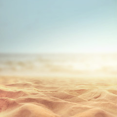 Sand beach tropical with blurred sea sky and sunny background, summer day, copy space or for product.