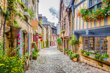 Beautiful alley scene in an old town in Europe Fototapete