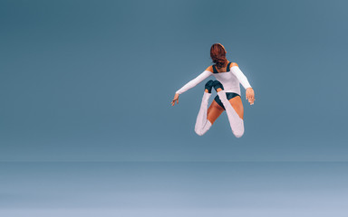 Modern Ballet Dancer Leaping in the Air