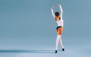 Modern Ballet Dancer Posing in a Studio