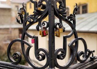 Metal fence with love locks