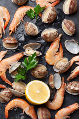 Foto op Canvas Schaaldieren Fresh seafood on stone table. Scallops and shrimps