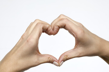 Heart from hands on a white background closeup