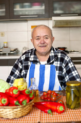 older man preparing vegetarian healthy eating