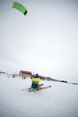 extreme freestyle ski jump with young man at winter season. snowkiting.