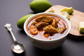 Homemade Mango Pickle or aam ka achar or achaar in white bowl, selective focus