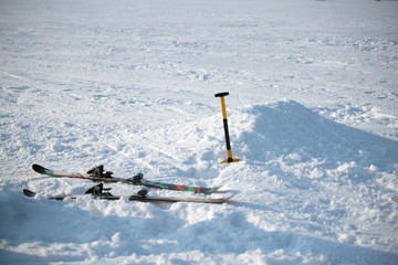Skis and shovel on snow in Sunny day