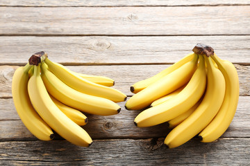 Sweet bananas on grey wooden table