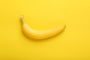 Sweet banana on the yellow background