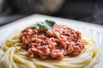 Spaghetti with meat sauce on white plate