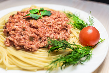 Spaghetti with meat sauce with cherry tomato