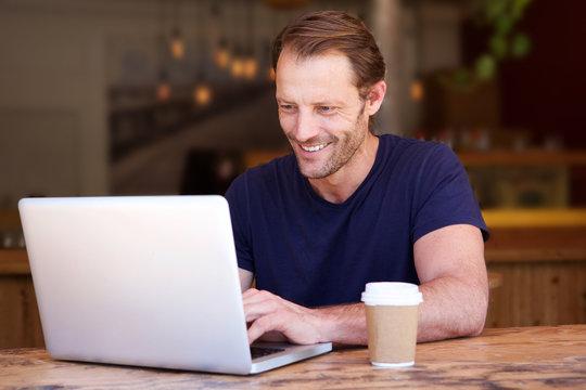 handsome man working on laptop