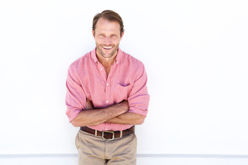 male fashion model smiling against white wall