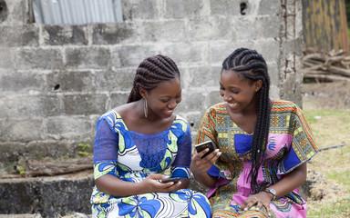 Young women having fun checking phones