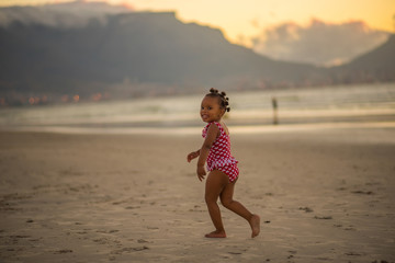 Little girl having fun at the beach