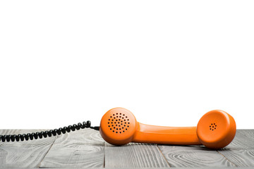 Handset on a table with  isolated background