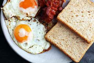 Ham and Egg. Bacon and Egg. Salted egg and sprinkled with black pepper. English breakfast.