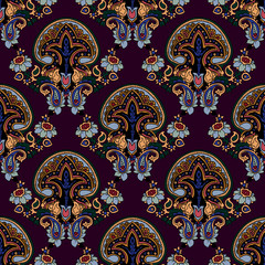 Abstract geometric seamless paisley pattern. Traditional oriental ornament. Vivid colors on maroon background. Textile design.