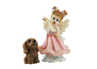 Isolated angel girl playing the flute with puppy toys photo.