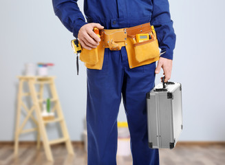 Electrician with tool box on white background, closeup