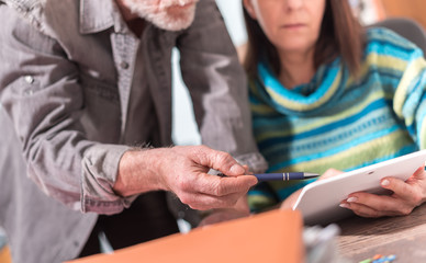 Senior business people working on tablet